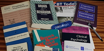 Array of psychology books and journals